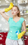 Tired woman cleaning home kitchen Royalty Free Stock Image