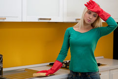 Tired woman cleaning kitchen Stock Photo