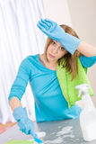 Tired woman cleaning kitchen Stock Images