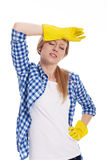 Tired woman after cleaning. Tired woman wearing a protective glove Stock Photography