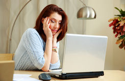 Tired woman with closing eyes sitting Royalty Free Stock Images