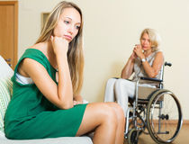 Tired woman and disabled person Royalty Free Stock Image