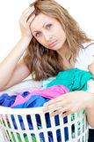 Tired woman doing laundry. Against a white background royalty free stock photos
