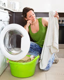 Tired woman doing laundry at home Royalty Free Stock Photo