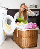 Tired woman doing laundry Royalty Free Stock Image