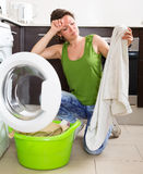 Tired woman doing laundry at home Royalty Free Stock Photography