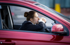 Tired woman driving car and looking through window Royalty Free Stock Photos