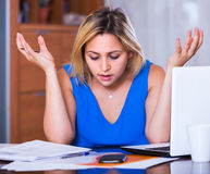 Tired woman employee doing paperwork Royalty Free Stock Photos
