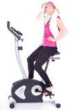 Tired woman exercising on stationary bicycle Stock Photography