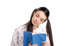 Tired woman falling asleep reading. Beautiful girl in pajamas falling asleep with a book in her hands. Isolated on white background stock image