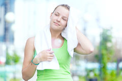Tired woman after fitness time and exercising in city street par Stock Photo