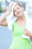 Tired woman after fitness time and exercising in city street par Royalty Free Stock Image