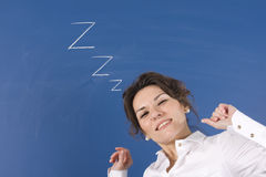 Tired woman in front of blue board. Business woman sleep in office Royalty Free Stock Photo
