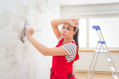 Tired woman grinding wall Stock Image