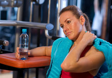 Tired woman in gym. After exercise Stock Photo