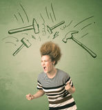 Tired woman with hair style and headache hammer symbols Royalty Free Stock Photos