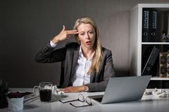 Tired woman hates her job stock photos