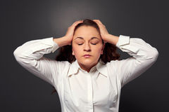 Tired woman have a headache Royalty Free Stock Photo