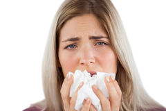 Tired woman having a flu. And using handkerchief Royalty Free Stock Image