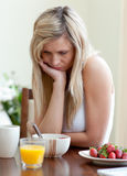 Tired woman having an healthy breakfast Stock Images