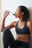 Tired woman having a water break Stock Image