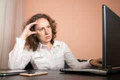 Tired woman with headache using laptop. Tired woman with a headache using a laptop Stock Image