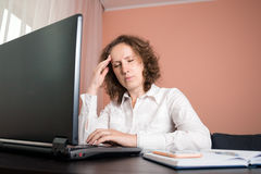 Tired woman with headache using laptop. Tired woman with a headache using a laptop Royalty Free Stock Images