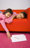 Tired woman and her daughter Stock Photography
