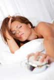 Tired woman holding alarm clock Stock Photography