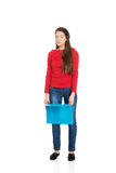 Tired woman holding blue folder. Exhausted student woman holding blue folder royalty free stock photo