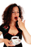 Tired woman holding coffee cup. stock photo
