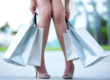 Tired woman holding shopping bags Stock Photos