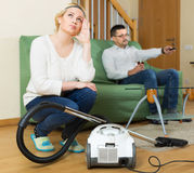Tired woman with hoover Stock Photo