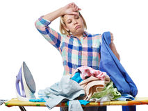 Tired woman housewife ironed clothes isolated Stock Images