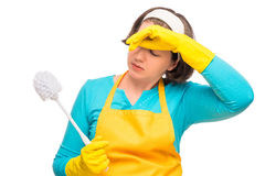 Tired woman housewife with toilet cleaning brush Royalty Free Stock Image
