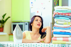Tired woman after ironing clothes, home interior Royalty Free Stock Photography