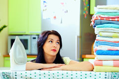 Tired woman after ironing clothes, home interior Royalty Free Stock Image