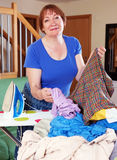 Tired woman irons clothes Royalty Free Stock Images