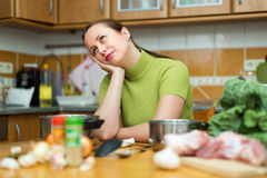 Tired woman at kitchen Royalty Free Stock Image