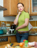 Tired woman at kitchen Stock Photo