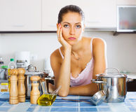 Tired woman at the kitchen Royalty Free Stock Photos