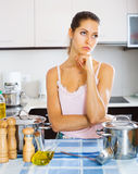 Tired woman at the kitchen Stock Photo