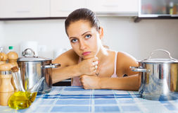Tired woman at the kitchen Stock Images