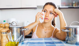 Tired woman at the kitchen Royalty Free Stock Photo
