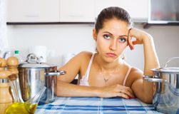 Tired woman at the kitchen Royalty Free Stock Photography