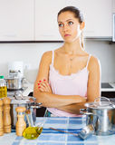 Tired woman at the kitchen Stock Photography