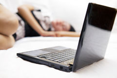 Tired woman with laptop Royalty Free Stock Photos