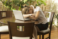 Tired woman with Laptop Stock Image
