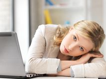 Tired woman with laptop computer Royalty Free Stock Photography