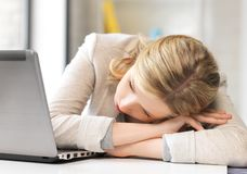 Tired woman with laptop computer Stock Photos